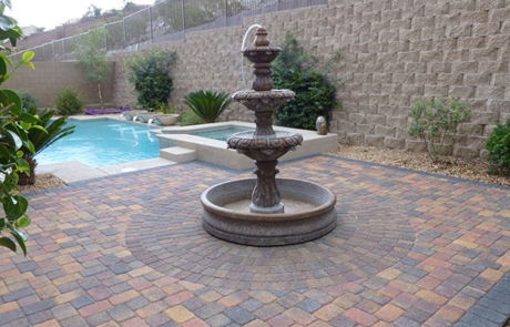 brick stone paver patio and water fountain element