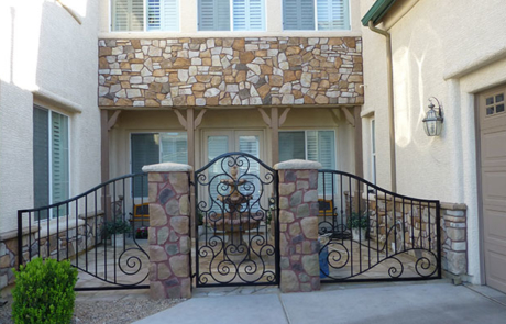 stone feature elements and wrought iron gate and fence for courtyard