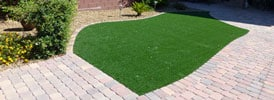 paver yard and patch of grass landscaping