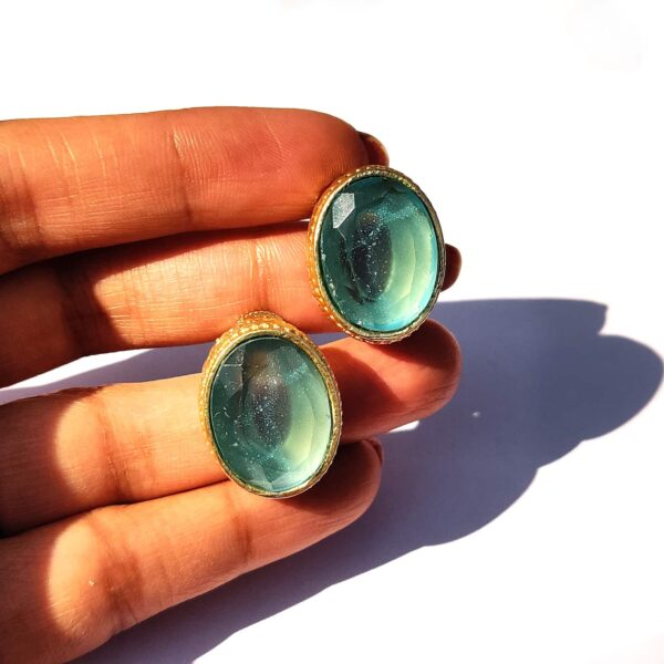Ocean Blue Topaz Goldplated Studs with Detailed Bezel Hand