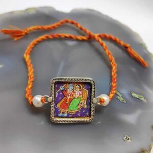 Sterling Silver Miniature Hand Painted Radha Krishna Rakhi Front