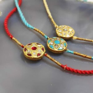 Gold Rakhi with Diamond and Gemstone Kundan Work (Set of 3) Side 1