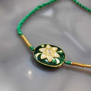 Reversible Gold Rakhi with Diamond Kundan and Enamel Back Main