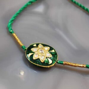 Reversible Gold Rakhi with Diamond Kundan and Enamel Back top