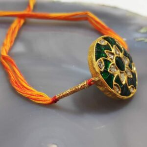 Reversible Round Gold Rakhi with Kundan and Enamel Back Side