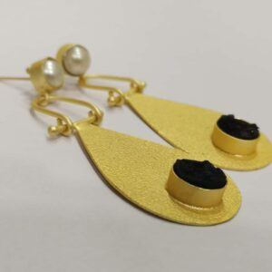 Golden Swing Dangler Black and White Earrings Side