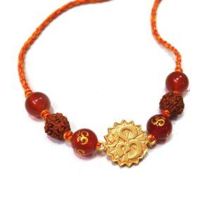 Natural Orange Gemstone Gold Plated OM and Rudraksha Rakhi