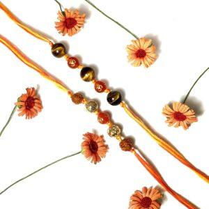 Natural Orange Onyx Om and Tigers Eye with Rudraksha 5 Bead Rakhi (Set of 2)