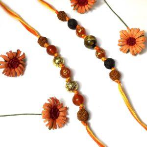 Natural Orange Onyx OM and Tigers eye with Rudraksha Rakhi Combo set of 2 for Bhaiya Image1