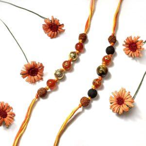 Natural Orange Onyx OM and Tigers eye with Rudraksha Rakhi Combo set of 2 for Bhaiya