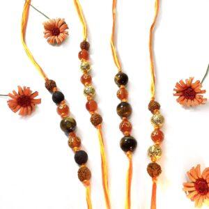 Natural Orange Onyx OM Lava and Tigers eye with Rudraksha Rakhi Combo Set of 4