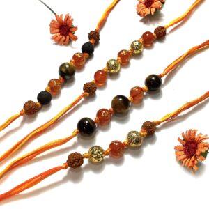 Natural Orange Onyx OM Lava and Tigers eye with Rudraksha Rakhi Combo Set of 4 Main Image