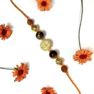 Natural Gemstone Tigers Eye with Gold plated OM and Rudraksha Rakhi for Bhaiya Image
