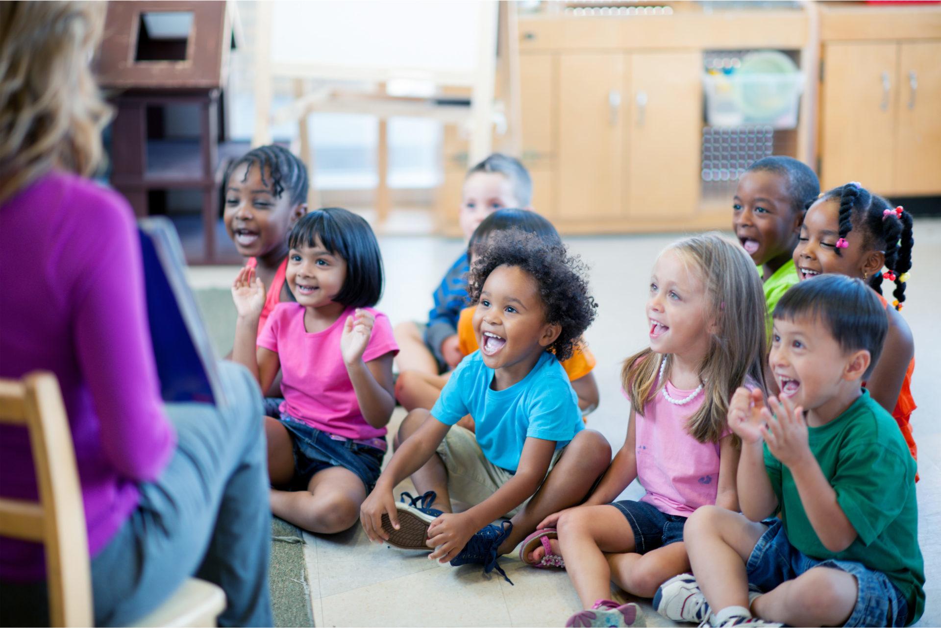 Happy children listening to storytime at school
