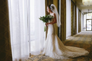 bride looking through window salt lake city hotel