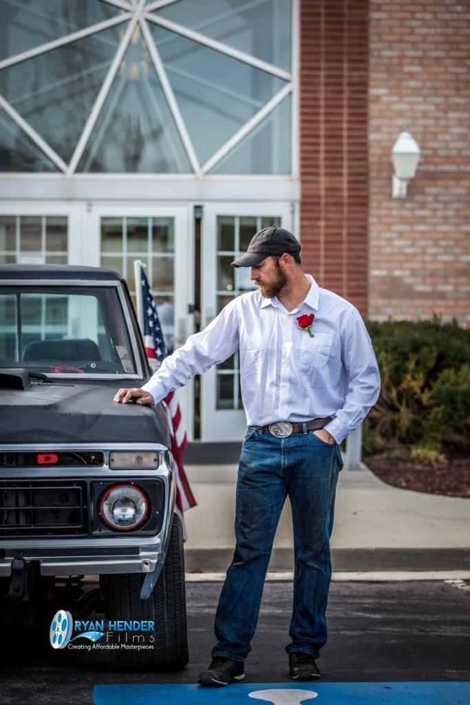best friend standing next to truck funeral photography utah Ryan hender films