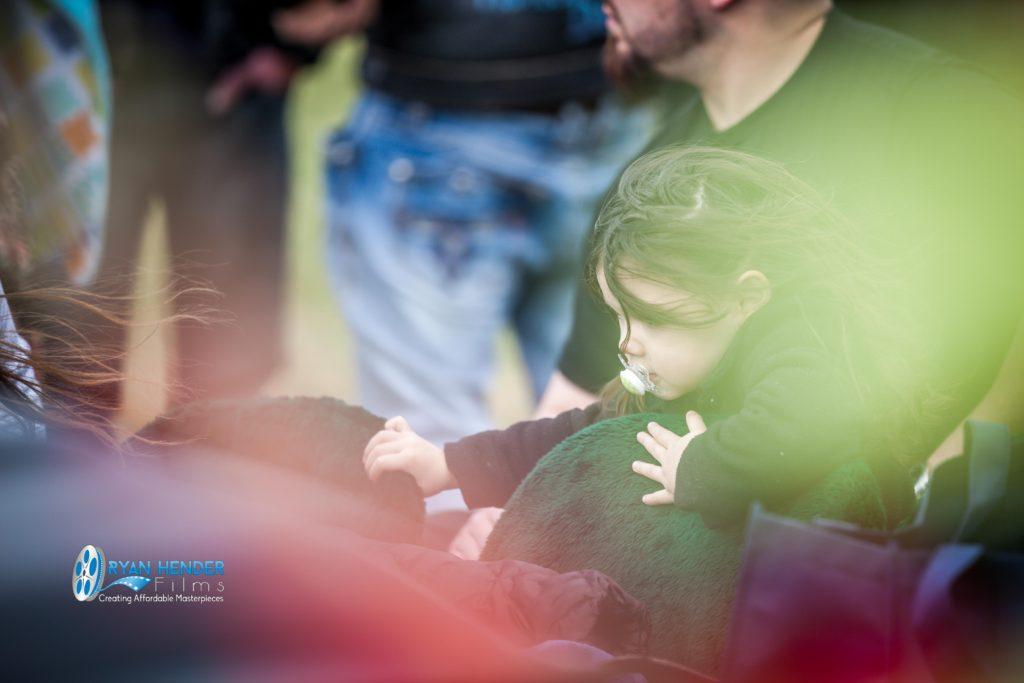 niece looking at casket funeral photography utah Ryan hender films