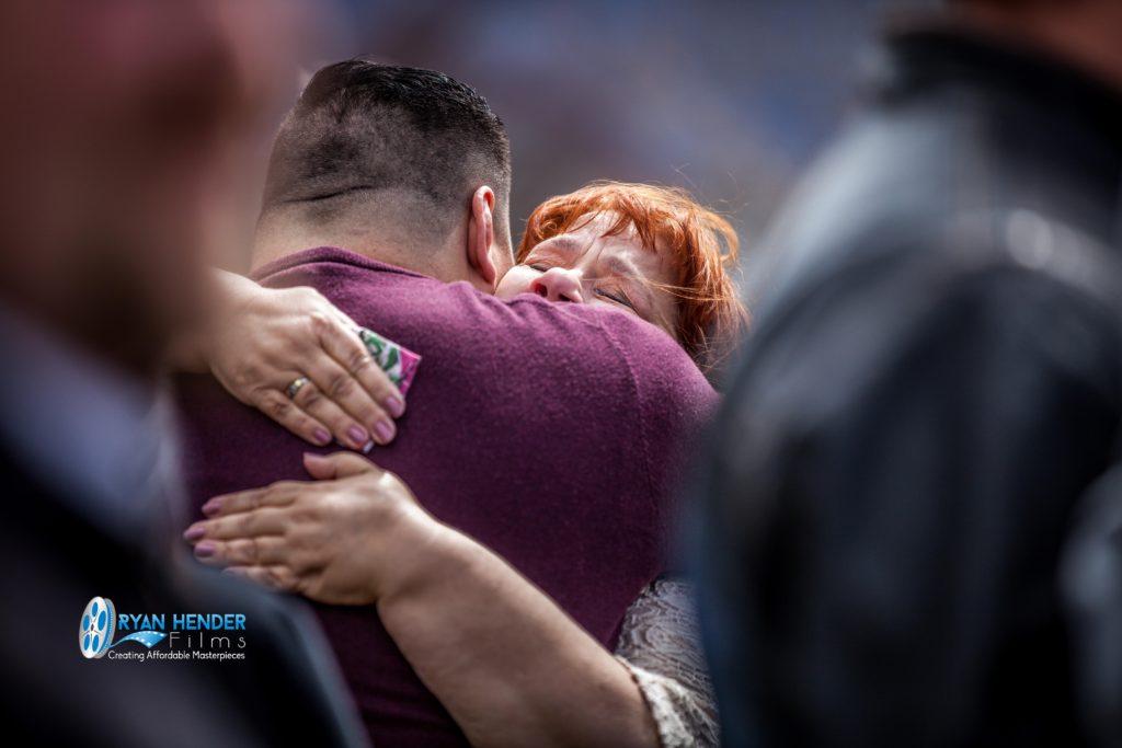 mom hugging friend funeral photography utah Ryan hender films