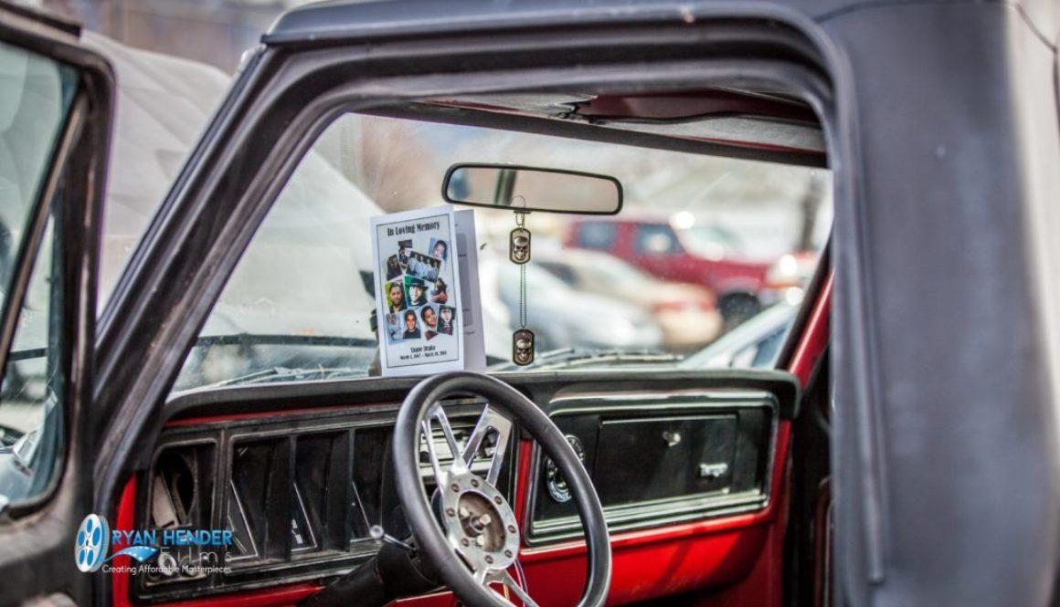 funeral program on dash of pickup funeral photography utah Ryan hender films