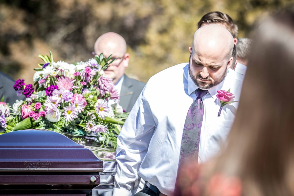 holding casket Wasatch lawn salt lake city cemetery photography for funerals Ryan hender films