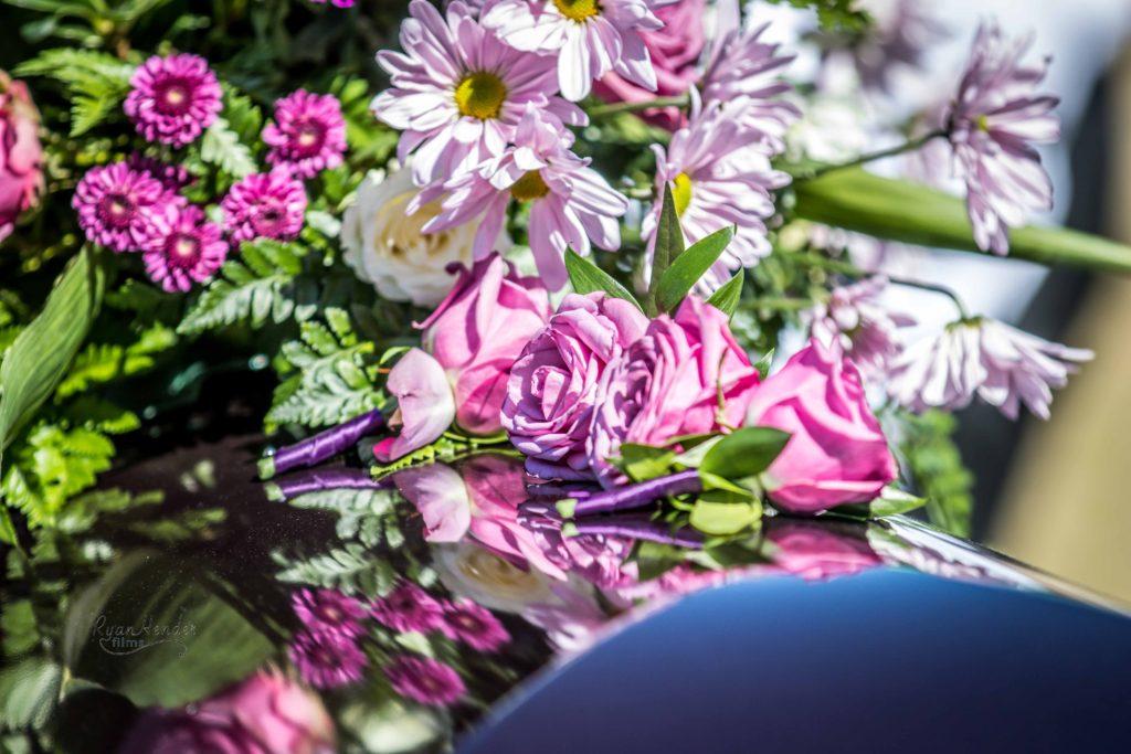 flowers reflecting in casket