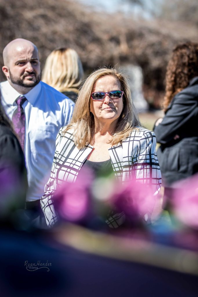 mother by flowers Wasatch lawn salt lake city cemetery photography for funerals Ryan hender films