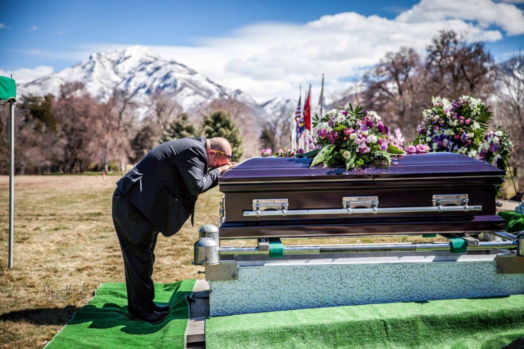 boyfriend kissing casket Wasatch lawn salt lake city cemetery photography for funerals Ryan hender films