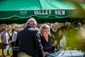 sister placing rose on casket funeral service salt lake city utah Ryan hender photography