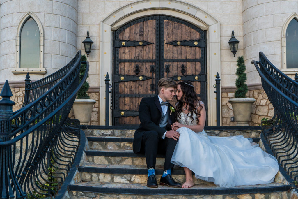 bride and groom on steps at wadley farms wedding venue utah wedding videography