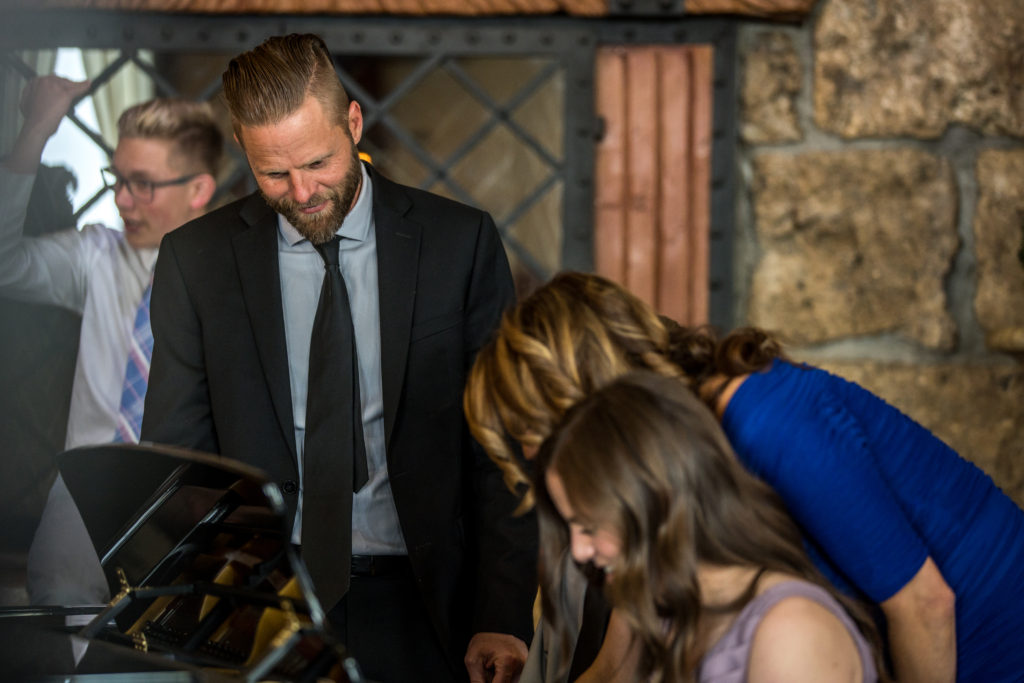 uncle playing piano at wedding wadley farms castle wedding venue