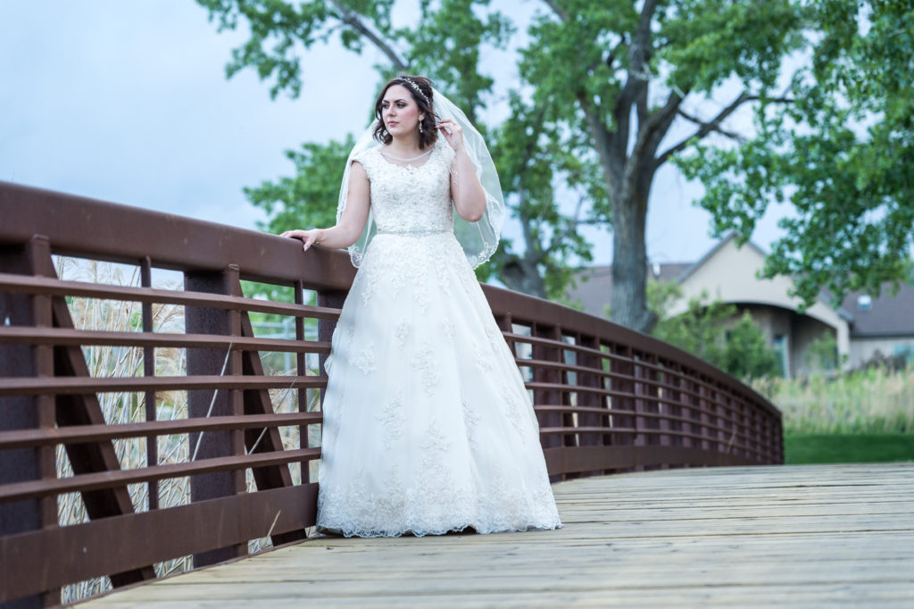 bride standing on bridge draper utah wedding photography