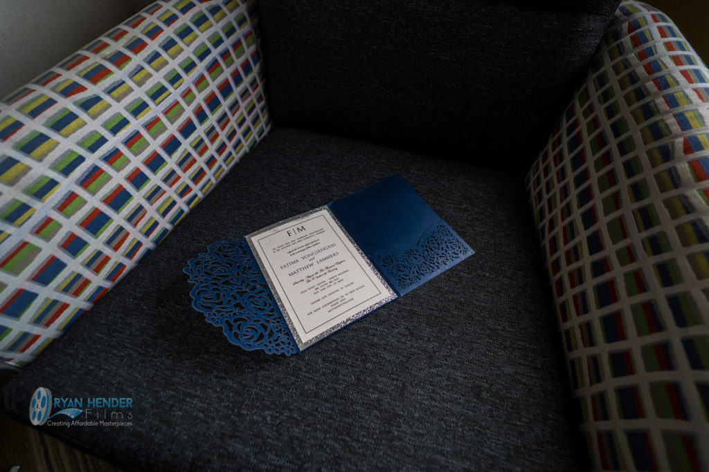 wedding invitation sitting on chair in hotel room