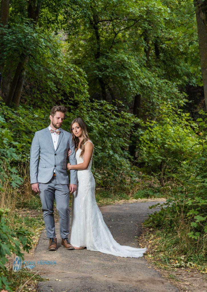 bride and groom beneath trees