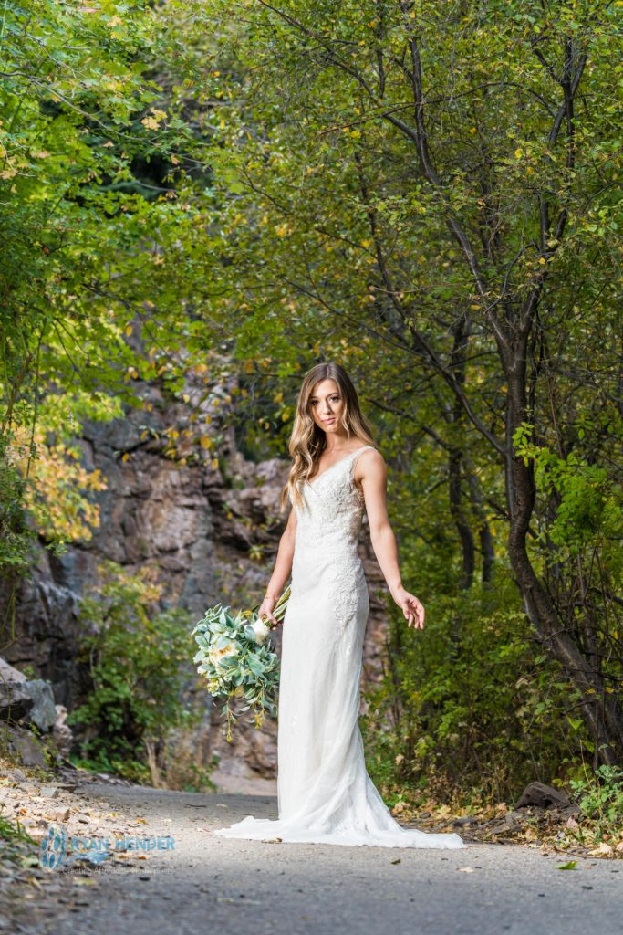 bride holding bouquet during photo shoot
