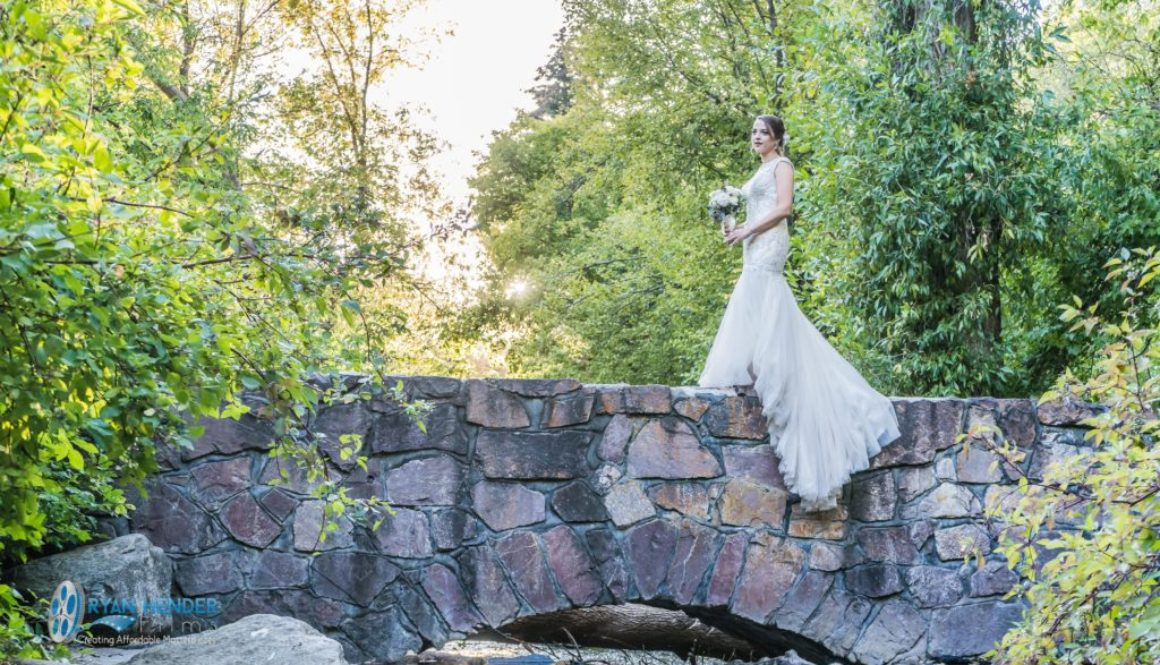 bride waiting on bridge for groom