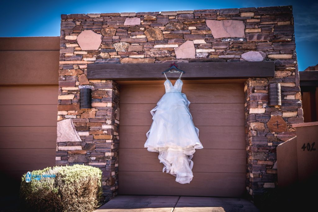 bride's dress hanging on garage