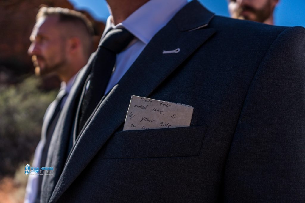 hand written wedding vows in groom's pocket
