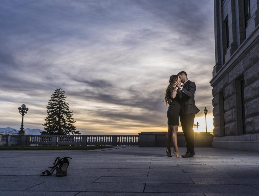 engagement photo with bride and groom at sunset salt lake city utah capitol