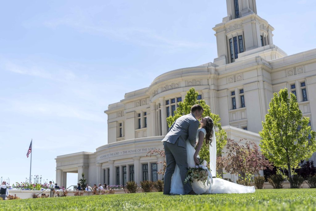 bride and groom dip at the Payson temple in utah photography