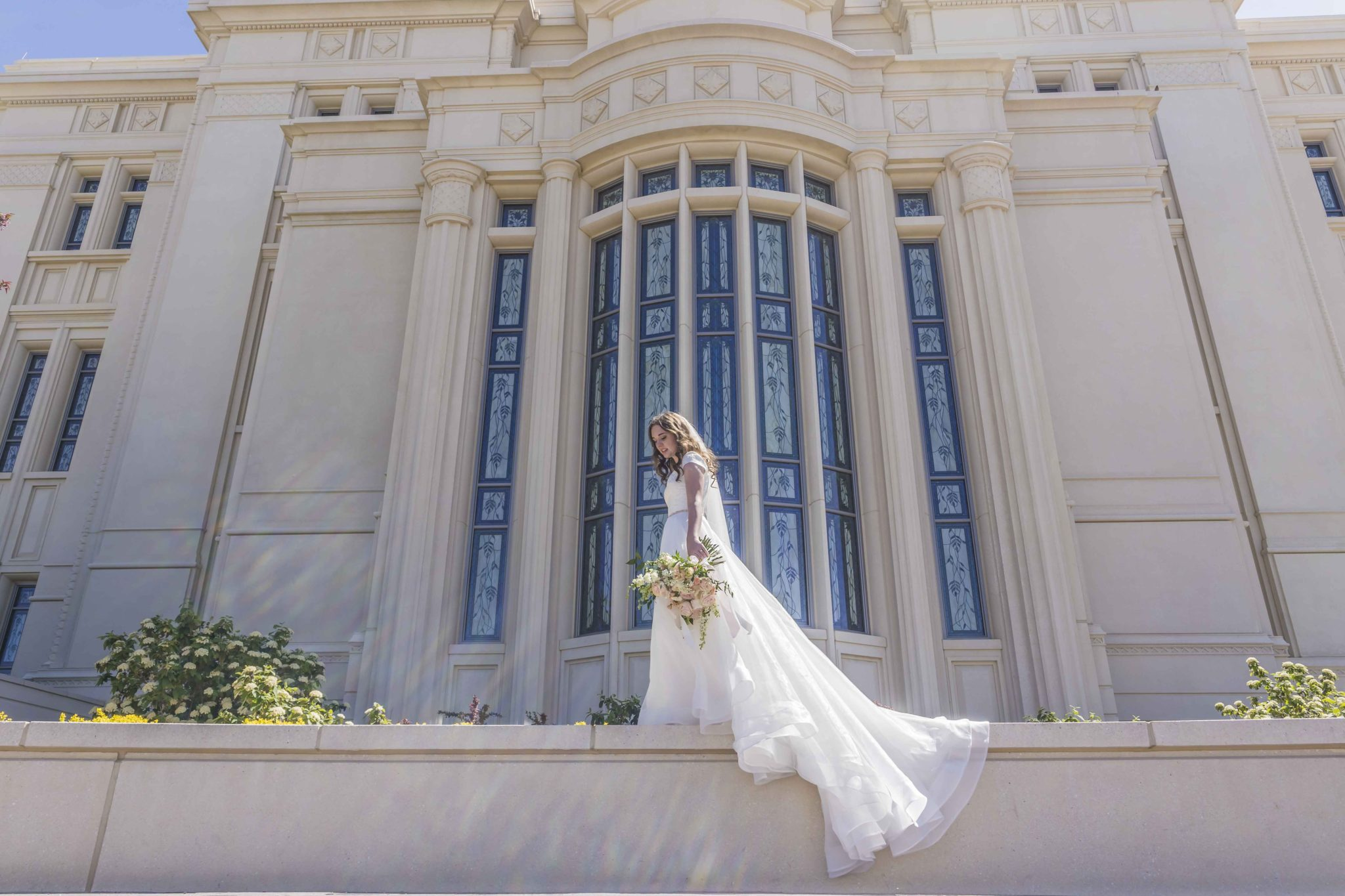 bride standing on wall dress