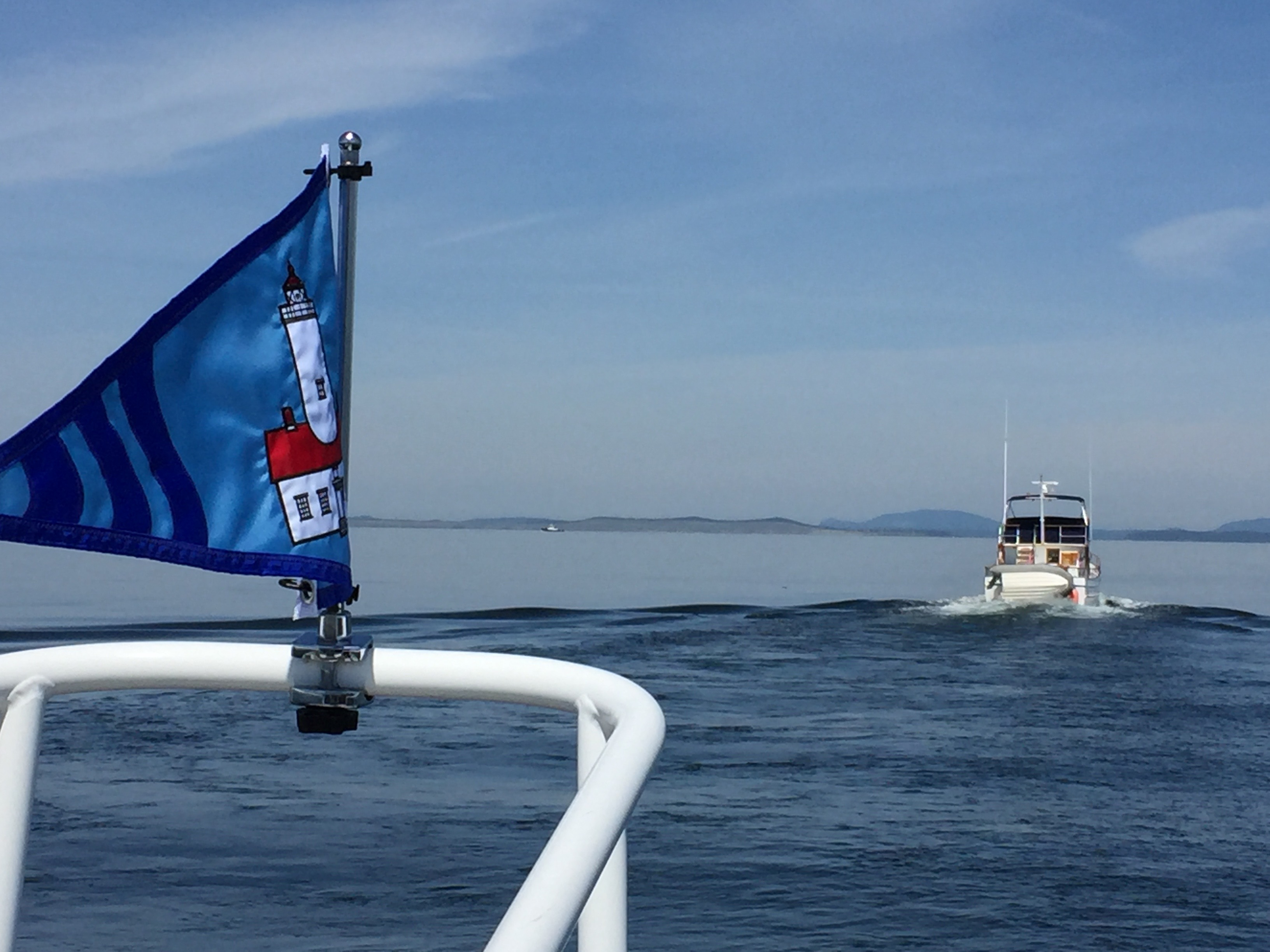 flying the North Olympic Sail & Power Squadron Burgee