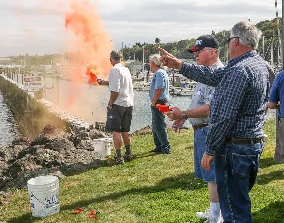 Members practice shooting flare guns and lighting flares at our annual picnic