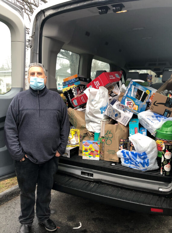"Nutmeg Big Brothers Big Sisters mentor on WTNH News with his annual ""Cram the Van"" toy drive"