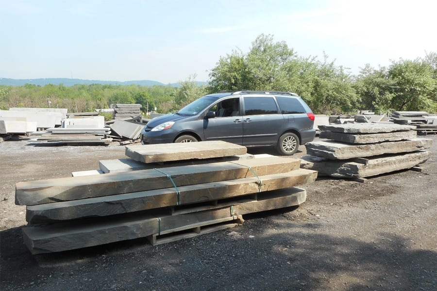 The size of the bridge rocks we carry becomes apparent next to the mini-van
