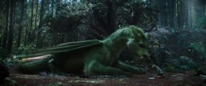 Elliott the dragon and Pete (Oakes Fegley) in Pete's Dragon. Photo credit: Disney Enterprises