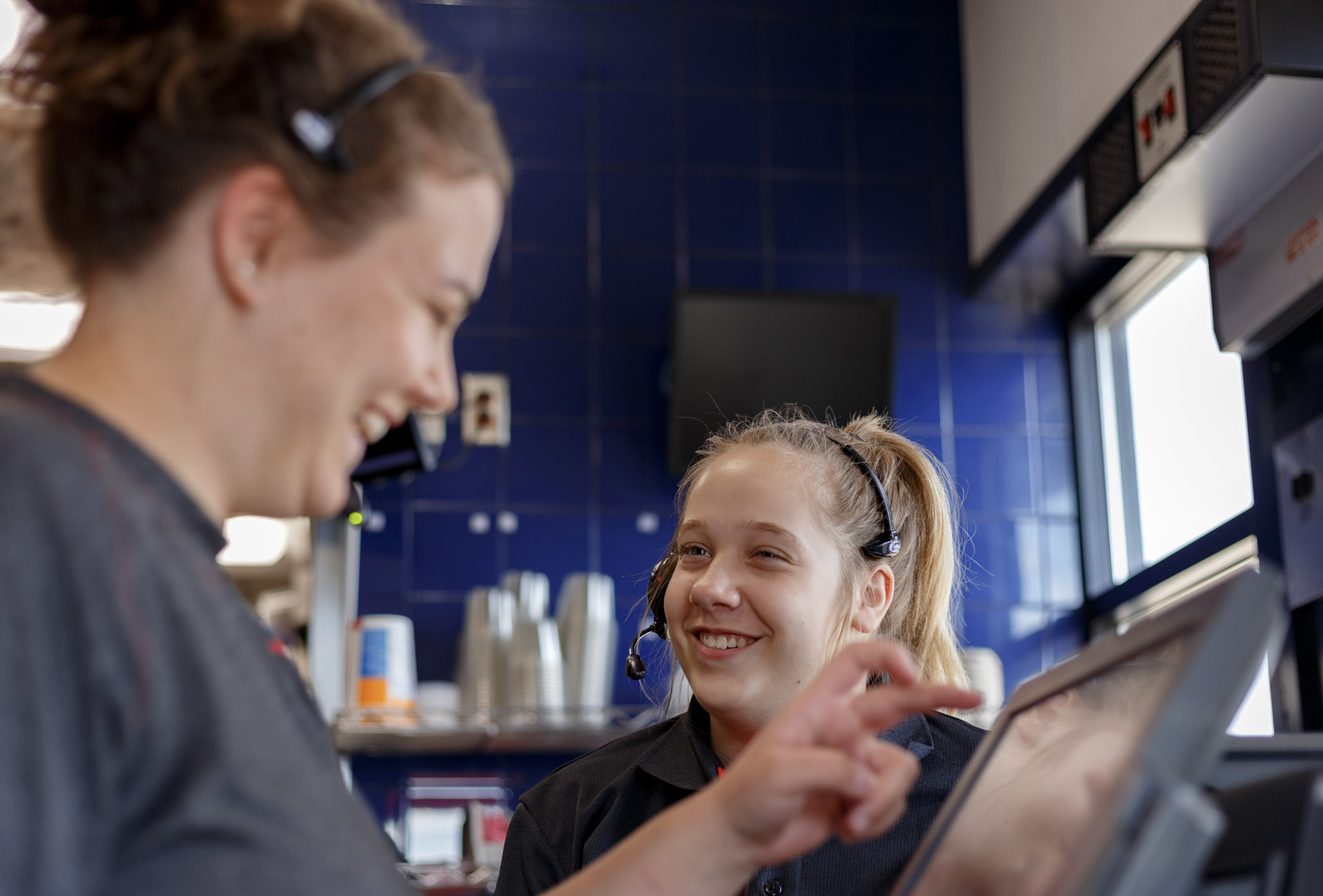 two Dairy Queen staff having fun at work