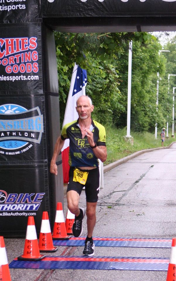Ken crossing the finish line Twinsburg Du