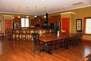 Dining room table seat 14, and a kitchen island seats 6