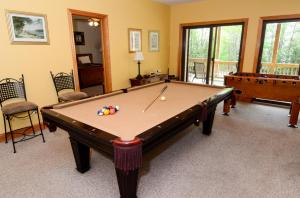 game room includes pool table and foosball