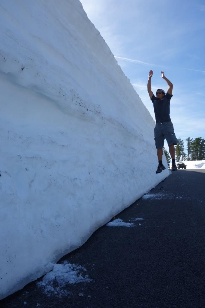 Jon using the snow bank to test his vertical jump